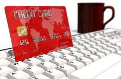 Credit card on computer keyboard closeup Royalty Free Stock Photos