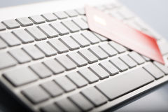 Credit card on a computer keyboard Stock Photography