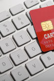 Credit card on a computer keyboard Stock Images