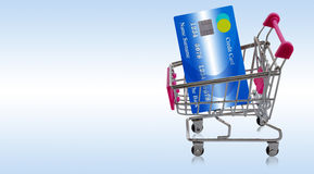 Credit Card Concept. Credit card on shopping trolley or cart, online payment, electronic commerce financial concept Royalty Free Stock Photo