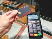 Credit card contactless payment in a bakery store. stock photo