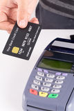 Credit card with credit card machine Stock Images