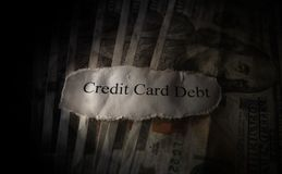 Credit Card Debt. Paper scrap on hundred dollar bills Stock Photo