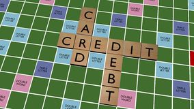 Credit card debt crossword on fake scrabble board Stock Photo