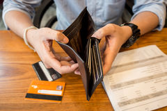 Credit card debt. Holding an empty wallet Stock Photos