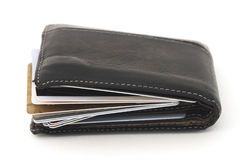 Credit Card Debt. Isolated wallet with stuffed credit cards Royalty Free Stock Image
