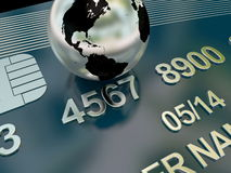 Credit card detail with planet earth. Focus on credit card numbers and abstract earth Royalty Free Stock Image