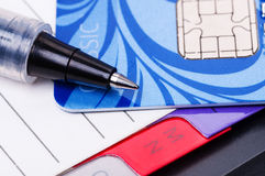 Credit card, diary and pen. Close up Stock Images