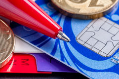 Credit card, diary, pen and coins Royalty Free Stock Photos
