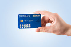Credit card with display and keypad. Hand holding credit card with display and keypad Stock Images