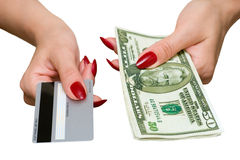 Credit card and dollars. The female hand holds credit card and dollars Stock Photos