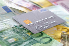 Credit Card and euro. Silver Credit Card with euro banknotes Stock Photo
