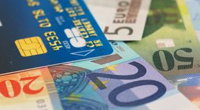 Credit card and euro banknotes. Credit card and mix of euro and  swiss banknotes Royalty Free Stock Image