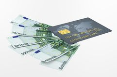 Credit card and euro bills. Blue credit card and 100 euro bills Royalty Free Stock Photography