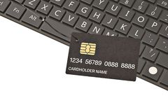 Credit card on fishing hook and laptop computer keyboard.3D illu. Stration stock images