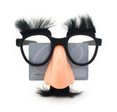 Credit Card Fraud. Diguise glasses with a generic credit card on a background. Identity theft concept royalty free stock images