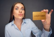 Credit card for fun. Woman bank employee. Holding payment plastic card Stock Photos
