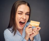 Credit card for fun. Woman bank employee Royalty Free Stock Images