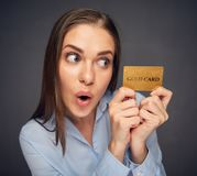 Credit card for fun. Woman bank employee. Holding payment plastic card. Close up face Stock Image