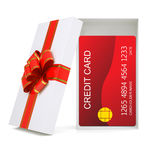 Credit card in gift box on white Stock Photos