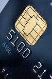 Credit card with gold chip. Closeup of a credit card with a gold chip royalty free stock photography
