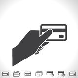 Credit Card in Hand Vector Icon Stock Photos