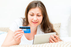 Credit card in the hands of a  girl Royalty Free Stock Image