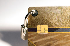 Credit card with hanging padlock Stock Photo