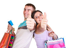 Credit card and happy shoppers Royalty Free Stock Photography