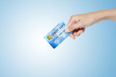 Credit card holded by hand. Credit card holded by hand over blue background Stock Photos