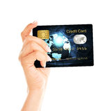 Credit card holded by hand over white. Background Royalty Free Stock Image