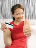 Credit card holding young women Stock Photo