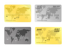 Credit card icons with world map,  on white background. Horizontal location. Golden and silver colors Stock Photos