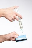 Credit card injected with money Stock Photo
