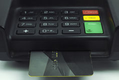 Credit Card inserted into a pin pad terminal - EMV Chip Stock Images