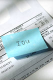Credit card IOU 2. With the current economic situation, many are unable to pay their debts. Closeup of credit card statement and IOU note Royalty Free Stock Images