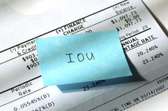 Credit card IOU. With the current economic situation, many are unable to pay their debts. Closeup of IOU note on credit card statement Stock Photography