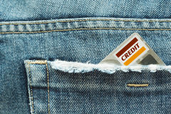 Credit card and jeans. A generic credit card in a jeans pocket stock photos