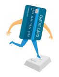 Credit card jumping on enter key or buying online Royalty Free Stock Photos