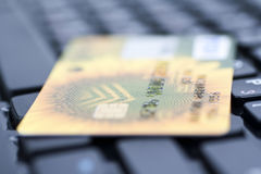 Credit card on keyboard. Credit card on black keyboard Royalty Free Stock Images