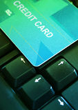 Credit card on a keyboard. Credit card on a computer  keyboard Royalty Free Stock Image