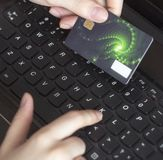 Credit card keyboard hands stock photography