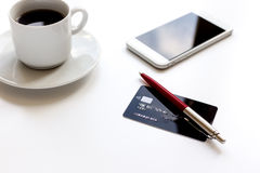Credit card, keyboard, smartphone and coffee cup on white background Stock Photography