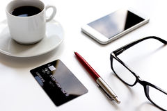 Credit card, keyboard, smartphone and coffee cup on white background Royalty Free Stock Photography