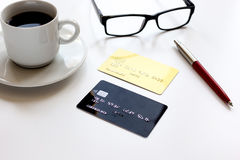 Credit card, keyboard, smartphone and coffee cup on white background Royalty Free Stock Photo