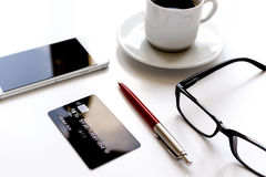 Credit card, keyboard, smartphone and coffee cup on white background Stock Images