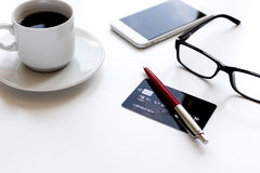 Credit card, keyboard, smartphone and coffee cup on white background Royalty Free Stock Images