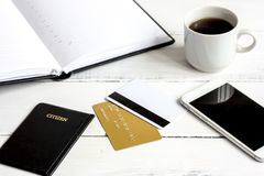 Credit card, keyboard, smartphone and coffee cup on wooden background Stock Images