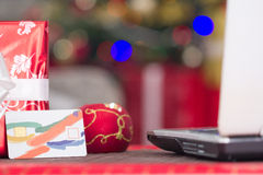 Credit card and lap top,Christmas night e-shop concept Royalty Free Stock Image