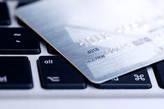 Credit card on laptop Stock Images